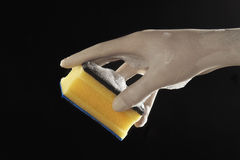 Hand with scourer Stock Image