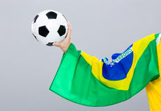 Hand scratch with football with brazil flag Royalty Free Stock Photography