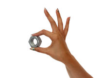Hand with a screw nut. Woman holding screw nut in hand Royalty Free Stock Photos