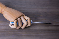 Hand with a screwdriver Stock Image