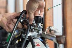 Hand on scuba gear Stock Image