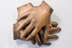 Hand Sculpture. Sculpture of three bronzed hand in a pile Stock Photography