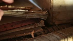 Old dusty manuscripts. Hand searching through old dusty stored manuscripts stock video