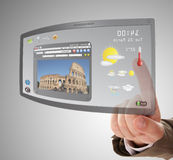 Hand searching a tourist information. Hand searching a information on touchscreen tablet Stock Photography
