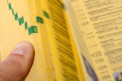 Hand searching the yellow pages Royalty Free Stock Image
