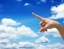 Hand select. On blue sky background Royalty Free Stock Photos