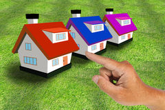 Hand select house Stock Photos