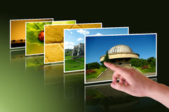 Hand selected photos on virtual desktop. Hand selects photos on virtual desktop Royalty Free Stock Image
