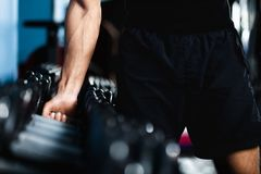 Hand selecting a dumbbell Stock Image