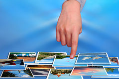Hand selecting summer holidays photos Stock Photo