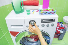 Hand selects the wash mode. Royalty Free Stock Photos