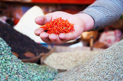 The hand of a seller with saffron in the salt market of the Old City of Sana'a, Yemen, spices. The Old City of Sana'a, the oldest continuously inhabited and stock photography