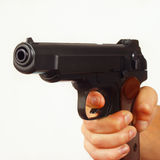 Hand with semi-automatic gun closeup Royalty Free Stock Photo