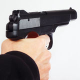 Hand with semi-automatic handgun Stock Photos