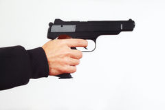 Hand with semi-automatic pistol on white background Stock Photo