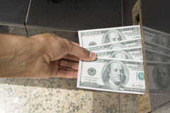 Hand sending a mail with dollar bills Royalty Free Stock Image