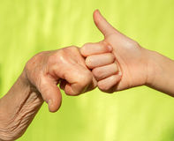 Hand of senior and child Stock Images