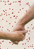 Hand of senior couple holding hands Stock Images