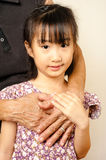 Hand of senior hugging with her child. Asian llttle girl embrace Royalty Free Stock Images