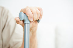 Hand of senior man on cane Royalty Free Stock Images