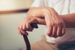 Hand of a senior man holding Stock Photos