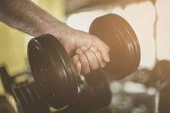 Hand of senior man. Holding weight. Man workout in the Stock Photography