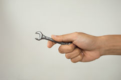 Hand of serviceman with a spanner Royalty Free Stock Photography