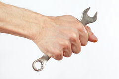 Hand of serviceman with a wrench Royalty Free Stock Photo