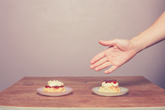 Hand serving cream tea Stock Image