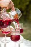 Hand serving sangria in a glass Royalty Free Stock Images