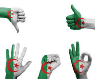 Hand set with the flag of Algeria Royalty Free Stock Photography