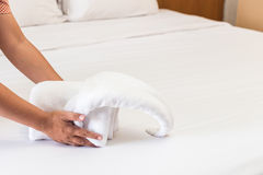 Hand set up white bed sheet in hotel room Royalty Free Stock Image
