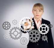 Hand sets business gears in motion Royalty Free Stock Photos