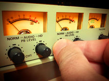 Hand setting audio level Stock Photo