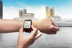 Hand setting route for GPS on the smart watch. Technology concept Stock Images