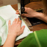 Hand sewing. She sews on the old sewing machine Stock Photos