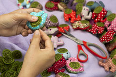 Hand sewing and cloth dolls Royalty Free Stock Images
