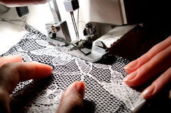 Hand sewing on the machine Stock Photo