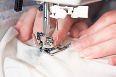 Hand sewing on a machine Royalty Free Stock Images