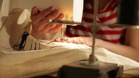 Hand sewing machine close up stock footage