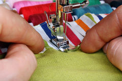 Hand sewing on a machine Stock Image