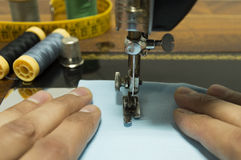 Hand sewing on an old sewing machine Stock Photography