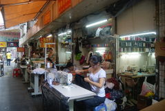 Hand sewing, Shenzhen in the East Gate commercial street Royalty Free Stock Image