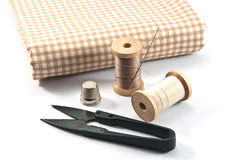 Hand sewing tools. Thimble, needles, spools and scissors for sewing on white background stock photos