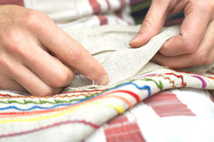 Hand sewing Stock Images