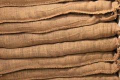 Hand sewn burlap bags Stock Photos
