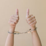 Hand in shackle Stock Photography