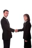 Hand shake. Young asian and american co-workers shaking hands Royalty Free Stock Photo