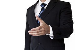 Hand shake. Business man gesturing a hand shake (hand is out of focus Royalty Free Stock Photography