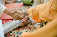 Hand Shake. Two men shaking hand in a solemnization  ceremony Stock Images